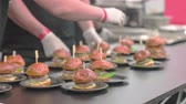 trimmings : Burger sliders being waiting at the expedition table Stock Footage