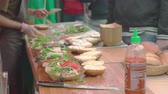trimmings : A burger waiting at the expedition table to be completed Stock Footage