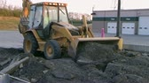 MIDDLETOWN - SEPTEMBER 12: Backhoe loader operator (name withheld) from Middletown, OH works to move crushed blacktop in parking lot September 12, 2007 in Middletown, OH; with external audio. Stock Footage
