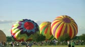 Time lapse of crowd of people watching hot air balloons competing for liftoff during a competition.   Stock Footage