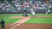 DAYTON - AUGUST 2: Batter (name withheld) gets called out at first base during regular season baseball game August 2, 2007 in Dayton, OH. Stock Footage