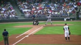 DAYTON - AUGUST 2: Batter (name withheld) gets called out at first base during regular season baseball game August 2, 2007 in Dayton, OH; with audio.