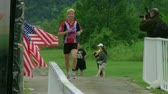 WAYNESVILLE - JULY 5: Female runner (name withheld) from Ohio crosses finish line at the Caesar Creek Triathlon and Dualthon held at Caesar Creek State Park July 5, 2009 in Waynesville, OH.