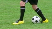 field : Young soccer player demonstrates footwork by dribbling ball, dolly shot.