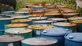 rez : Old rusty barrels with oil products casks