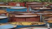 ferrugem : Old rusty barrels with oil products casks