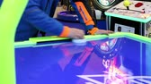 play video game : Playing air hockey game