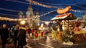 roundabout : People on Christmas market on Red Square, decorated and illuminated for Christmas in Moscow, Russia