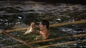 habitação : Baptism of Jesus holiday. Epiphany swimming in Jordan ice hole Stock Footage
