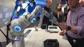 manuseio : Festo presenting bionic workplace on Messe fair in Hannover, Germany