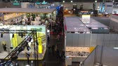 посетителей : Visitors in exhibition stands and booths on Messe fair in Hannover, Germany