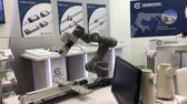 zbraně : Automatic controlling machine in robot industry on TBI motion stand on Messe fair in Hannover, Germany Dostupné videozáznamy