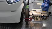 almanca : Automatic wheel assembly on IBG electrical car on Messe fair in Hannover, Germany Stok Video