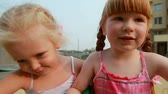 roundabout : Two little girls on carousel Stock Footage