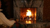lugar : Man relaxing in rocking chair in front of fireplace in room Vídeos
