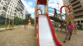 playful : Children spending time in playground slide Stock Footage