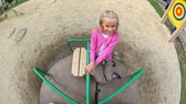 roundabout : High angle view of a little girl rolling on roundabout