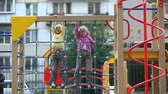 spiral : Two little girls climbing on playground net