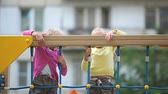 alerta : Two little children climbing on net to the top Stock Footage