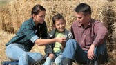 feno : Happy family of three spending time in countryside Vídeos
