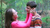closeness : Girl jumping at her boyfriend and them kissing  Stock Footage