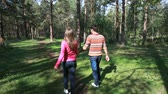 sevgili : Young couple walking in wood