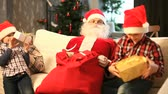 weihnachten : Santa giving Christmas presents to two happy kids