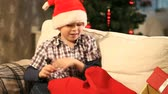 weihnachten : Boy taking presents out of Santa's sack