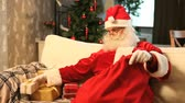 weihnachten : Santa putting presents into his sack Stock Footage