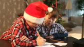 weihnachten : Two boys writing a letter to Santa Claus