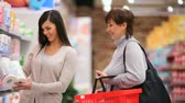 supermarket : Mother and daughter buying toilet paper Stock Footage