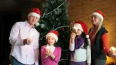 weihnachten : Cheerful family with sparklers celebrating Christmas and New Year Stock Footage