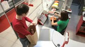 caixa : The above view of guy paying for groceries at the cashier desk