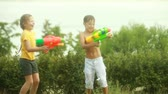 playful : Children fighting playfully with water guns