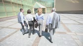 workgroup : Confident business team walking steadfastly outside in urban surroundings