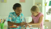 passatempo : Excited girls drawing in pencil together Stock Footage