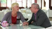 querido : Senior couple celebrating their wedding anniversary in restaurant Stock Footage