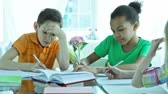 colega : Kids being deep in thought doing homework