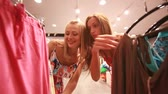 женский : Excited girls doing shopping on a spree day Стоковые видеозаписи