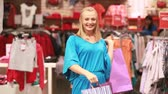 shoppingbag : Attractive blonde woman being happy with her spree purchases