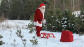 natal : Santa pulling sled with sack full of presents almost losing it when it suddenly falls down