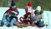 zimní čas : Parents and children having a winter picnic enjoying spending time with each other