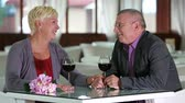 querido : Romantic senior couple enjoying wine at restaurant