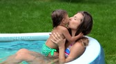 inflável : Young mother expressing love for her baby girl splashing in water Vídeos
