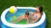 inflável : The above view of a cheerful family spending their healthy summer day in pool