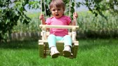 inocência : Little girl having a good time swinging Stock Footage
