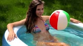 sensualidade : Lovely young lady enjoying herself in an inflatable pool