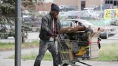 lixo : Vagabond pushing the cart full of trash on his long way to nowhere