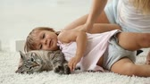 feline : Cute girl cuddling with her furry friend Stock Footage