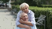 querido : Lovely senior lady expressing love for her husband embracing and kissing him